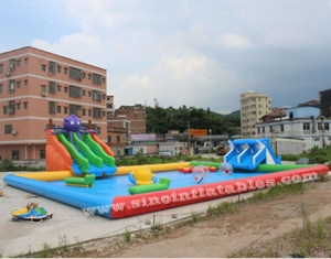 kids N adults large inflatable water park on land with big inflatable pool