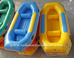 4 persons finishing or drifting inflatable raft