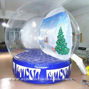 human giant inflatable Christmas snow globe