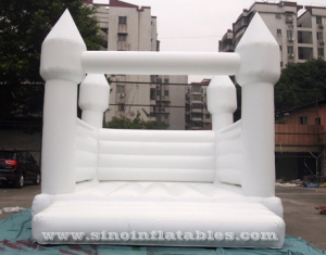 adults wedding all white bouncy castle