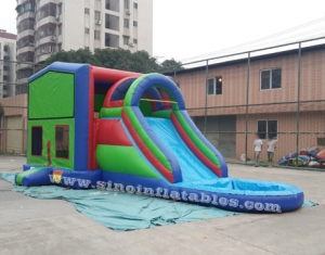 Outdoor inflatable bounce house with water slide
