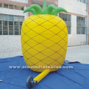 Huge yellow inflatable advertising pineapple