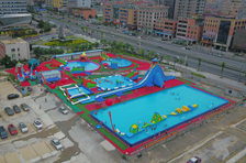 Our company set up a new giant inflatable water park on land for rental in Dongguan city
